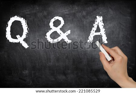 Writing Q&A, Questions and Answers on a blackboard - stock photo