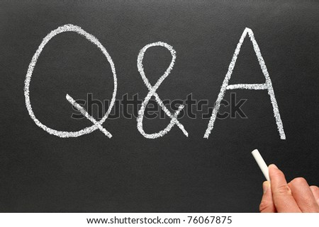 Writing Q&A, Questions and Answers on a blackboard. - stock photo