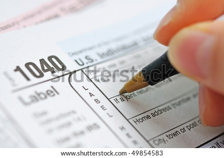 writing tax return - stock photo