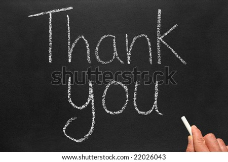 Writing thank you on a blackboard. - stock photo