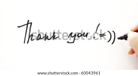 "Writing ""Thank you!"" with smile on the white - stock photo"