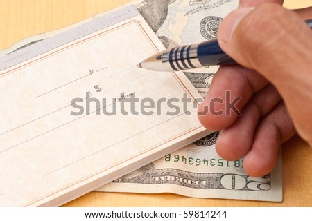 Writing The Check Amount - stock photo