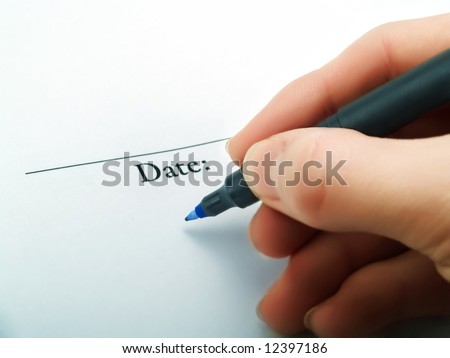 Writing the current date on a contract - stock photo