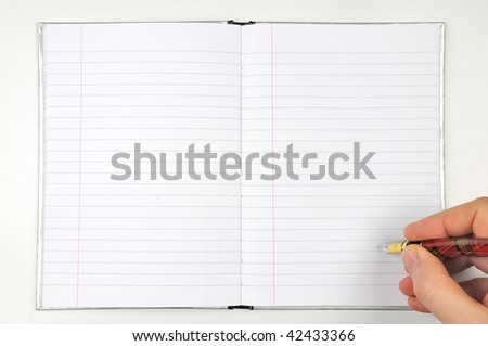 writing with ink pen on open blank notepad - stock photo