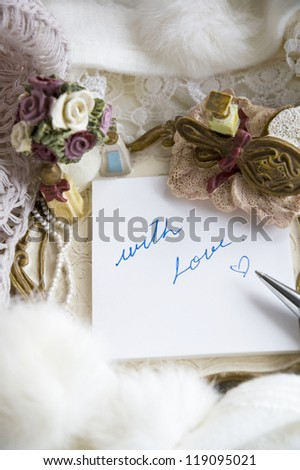 writing with love on note pad decorated with romance style