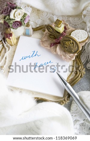 writing with love on note pad in romance style