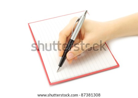 Writing woman hand in notepad on a white background - stock photo
