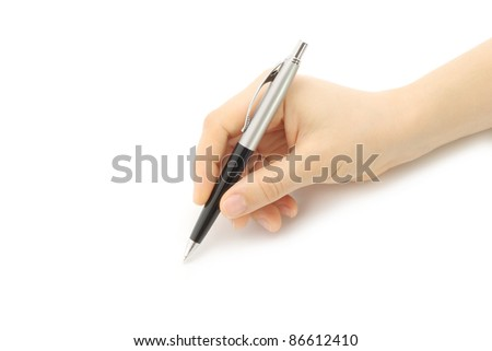 Writing woman hand on a white background - stock photo