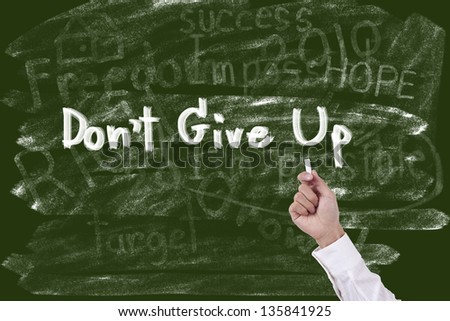 Writing word don't give up on blackboard - stock photo