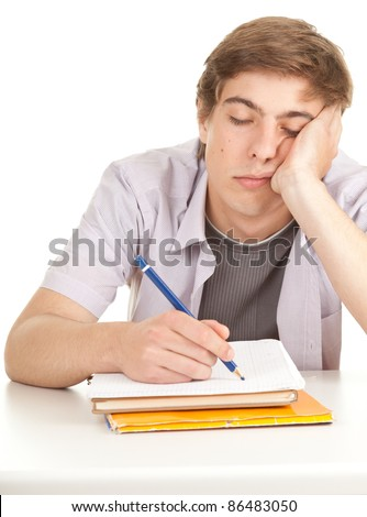 writing young male student with books - stock photo