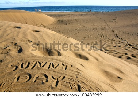 "Written in the sand ""Sunny day"", Gran Canaria,Spain - stock photo"