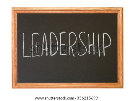Written in white chalk on a blackboard - leadership - stock photo