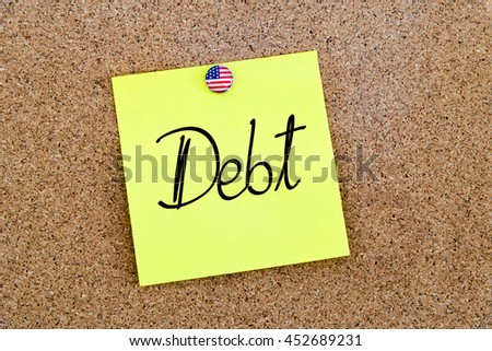 Written text Debt over yellow paper note pinned on cork board