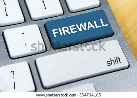 Written word Firewall on red keyboard button. Online Protection and Internet Security Concept. - stock photo