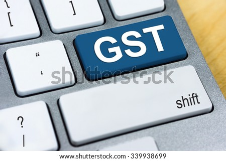 Written word GST on blue keyboard button