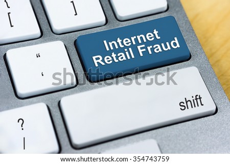 Written word Internet Retail Fraud on red keyboard button. Online Protection and Internet Security Concept. - stock photo