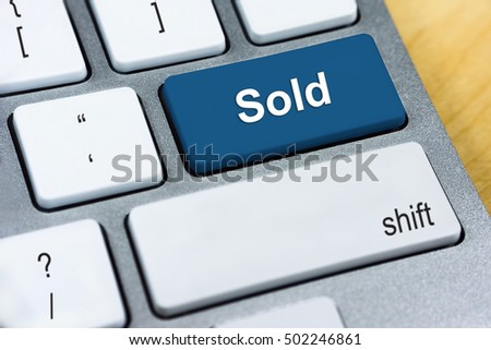 Written word Sold on blue keyboard button.
