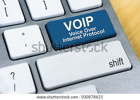Written word VOIP Voice Over Internet Protocol on blue keyboard button. Internet Protocol Concept