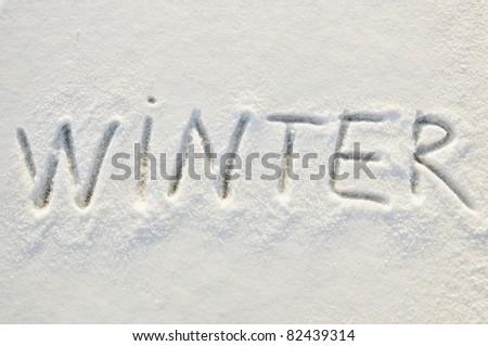 Written word winter on a snow field - stock photo