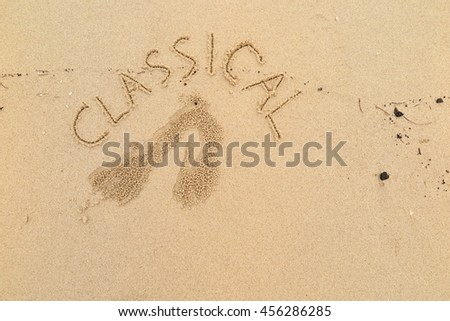 "written words ""CLASSICAL"" on sand of beach"