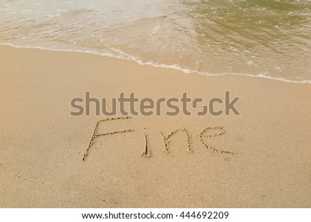 "written words ""Fine"" on sand of beach"