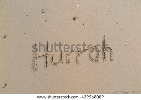 "written words ""Hurrah"" on sand of beach"