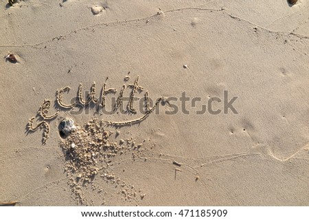 "written words ""security"" on sand of beach"