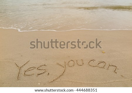 "written words ""Yes, you can"" on sand of beach"