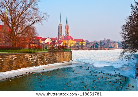 Wroclaw panorama in winter with ducks in Odra river - stock photo
