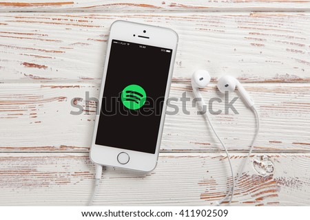 WROCLAW, POLAND - APRIL 12, 2016: Apple iPhone SE smartphone with Spotify app on screen - stock photo