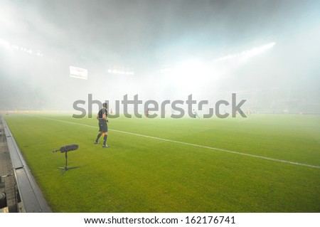 Wroclaw. POLAND - April 10: Match T-Mobile Ekstraklasa between Wks Slask Wroclaw and Zaglebie Lubin. Strong fog from piro on  April 10, 2013 in Wroclaw. Poland. - stock photo