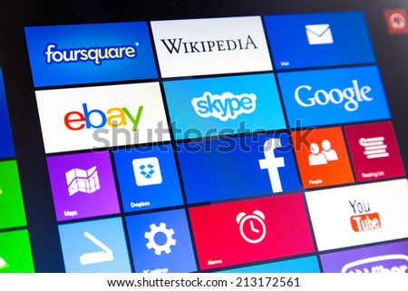 WROCLAW, POLAND - AUGUST 26, 2014: Photo of a Windows 8.1 operated laptop - start screen with most popular apps - stock photo