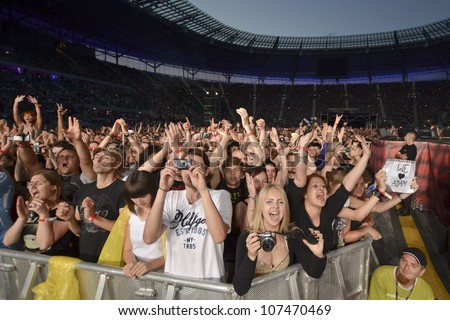 WROCLAW, POLAND - JULY 7:  Concert Queen + Adam Lambert in the Rock Festival in Wroclaw on July 7, 2012 in Wroclaw, Poland. The concert at the football stadium where they were Euro 2012 matches. - stock photo