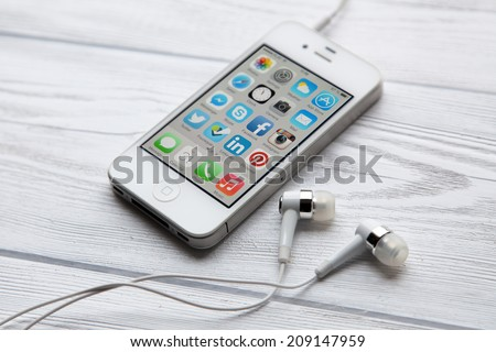 WROCLAW, POLAND - JULY 31, 2014: Photo of iPhone 4 smartphone device - stock photo
