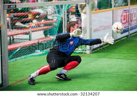 WROCLAW, POLAND- JUNE 8: Contestants   playing at the 1st International Championships in Street Soccer, June 08, 2009 in Wroclaw, Poland - stock photo