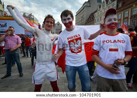 WROCLAW, POLAND - JUNE 8: Polish fans arrive in the  fanzone before match Euro 2012 between Poland - Grece in Wroclaw on June 8, 2012 in Wroclaw, Poland. Zone for the fans UEFA EURO Championship. - stock photo
