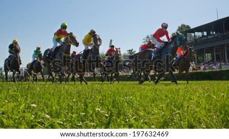 WROCLAW, POLAND - JUNE 8; 2014: Start the race for four-years old horse in a Racecourse WTWK Partynice. - stock photo