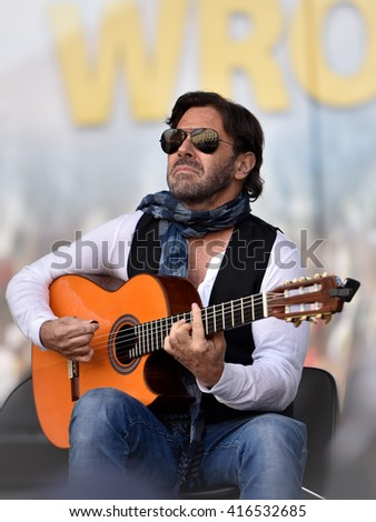 WROCLAW, POLAND - MAY 1, 2016: Al Di Meola during event Guitar Guinness World Record. Over 7 thousands guitarists achieve new Guiness Record playing Hey Joe by Jimi Hendrix. - stock photo