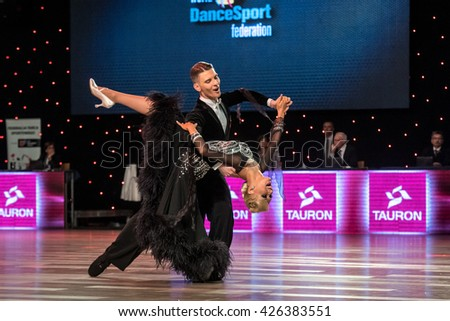 Wroclaw, Poland - May 14, 2016: Dmitry Zharkov and Olga Kulikova in dance pose during World Dance Sport Federation European Championship Standard Dance, on May 14 in Wroclaw, Poland