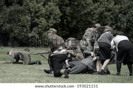 Wroclaw, Poland May 11. Retreat of Polish soldier during historical reenactment of WWII, May 11, 2014 Wroclaw, Poland - stock photo