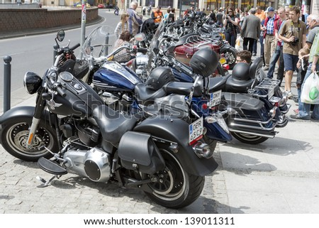 """WROCLAW, POLAND - MAY 18: View of Harley Davidson motorcycle parked in the city during """"Harley-Davidson Super Rally 2013"""" on 18, 2013 in Wroclaw, Poland. Europe's largest annual motorcycle event - stock photo"""