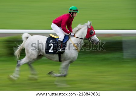 WROCLAW, POLAND - SEPTEMBER 21; 2014: Jockey K. Mazur on the horse  Debowy Pien before race for three year old arabian horse in a Racecourse WTWK Partynice. - stock photo