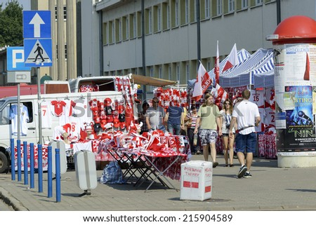 WROCLAW, POLAND - SEPTEMBER 6: Polish fans accessories stand in front of the sports hall during the European Championship in volleyball on 6 September 2014 in Wroclaw, Poland. - stock photo