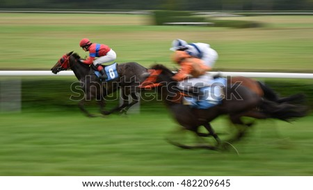 WROCLAW, POLAND - SEPTEMBER 4; 2016: Race for the 3-year and older horses Group IV Racecourse WTWK Partynice. Leads K. Maryniak on the horse Tutejsza (6).