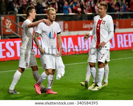 Wroclaw, Poland. 17th November, 2015. International Football friendly match: Poland v Czech Republic. Kamil Grosicki after shotting goal pays tribute to people died in Paris. - stock photo