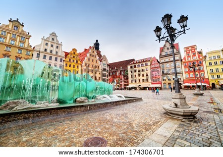 Wroclaw, Poland. The market square with the famous fountain and colorful historical buildings. Silesia region. - stock photo