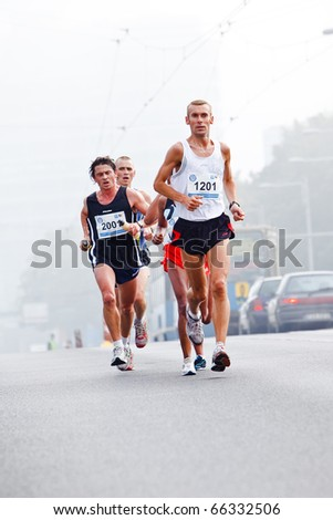 WROCLAW - SEPTEMBER 12: Wroclaw Marathon runners, September 12, 2010 in Wroclaw, Poland - stock photo
