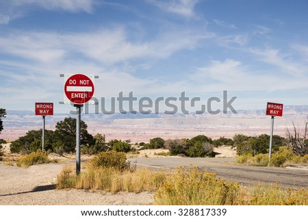 wrong way and do not enter signs along a road in the desert southwest - stock photo