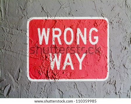 Wrong way  road sign painted on wall - stock photo