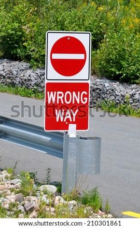Wrong way signage - stock photo